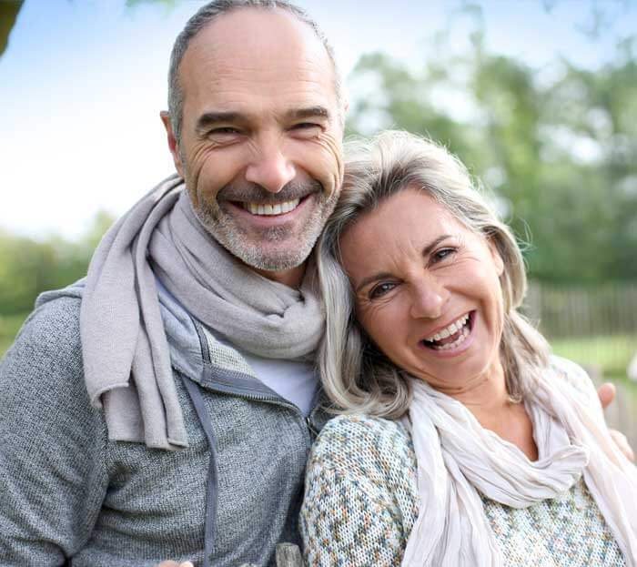 Couple Smiling - Implants